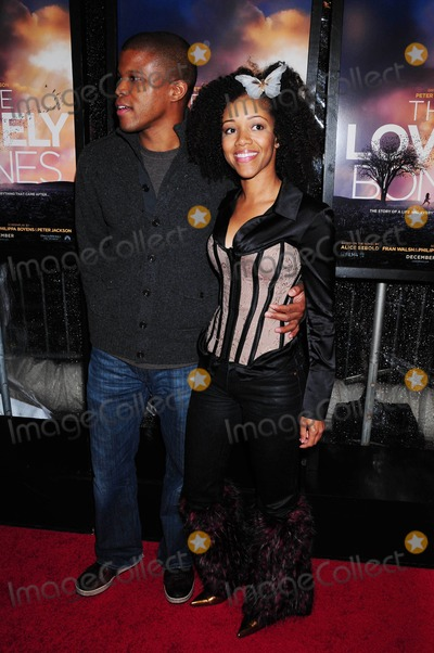 Chrystee Pharris Photo - the Screening of the Lovely Bones at the Paris Theater in New York City on 12-02-2009 Photo by Ken Babolcsay-ipol-Globe Photos Inc Chrystee Pharris and Sharif Atkins