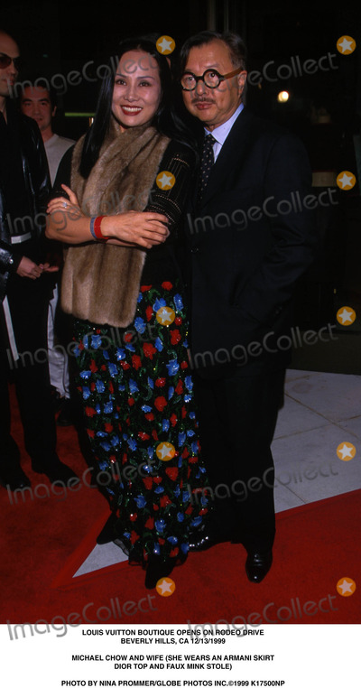 Mink Stole Photo - Louis Vuitton Boutique Opens on Rodeo Drive Beverly Hills CA 12131999 Michael Chow and Wife (She Wears an Armani Skirt Dior Top and Faux Mink Stole) Photo by Nina PrommerGlobe Photos Inc1999