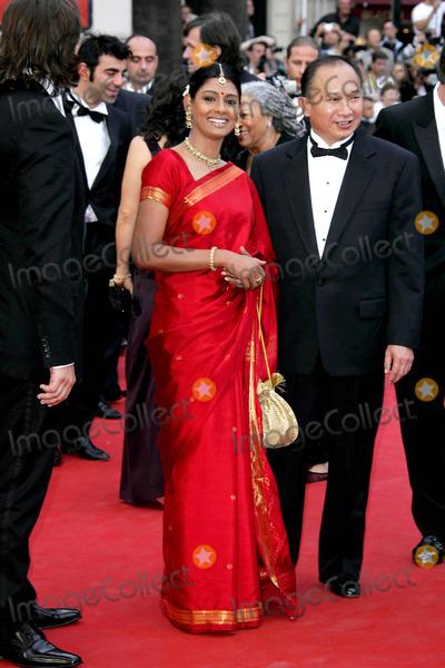 Nandita Das Photo - Nandita Das and John Woo Opening Night Premiere Lemming Cannes Film Festival Palais Des Festivals Cannes France 05-11-2005 Photo by Alec Michael  Globe Photos