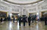Photo - US Capitol Police officers pay respects at the casket of slain US Capitol Police officer William Billy Evans as he lies in honor at the Capitol in Washington Tuesday April 13 2021Credit Susan Walsh  Pool via CNPAdMedia