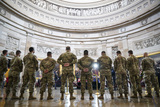 Photo - WASHINGTON DC - APRIL 13 National Guard troops pay their respects at the casket of the late US Capitol Police officer William Billy Evans during a memorial service as Evans lies in honor in the Rotunda at the US Capitol on April 13 2021 in Washington DC Officer Evans was killed in the line of duty during the attack outside the US Capitol on April 2 He is thesixthCapitol Police officer to die in the line of duty in the nearly 200 years since the force was created Credit Drew Angerer  Pool via CNPAdMedia
