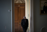 Photos From United States Senator Bob Menendez (Democrat of New Jersey) walks alone in the hallway outside the Senate chamber following a private conversation with United States Senator Lindsey Graham (Republican of South Carolina) at the U.S. Capitol