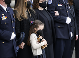 Photo - Abigail Evans the daughter of US Capitol Police officer William Evans who was killed in the line of duty on April 2 watches with family members as his casket is carried into the US Capitol in Washington US April 13 2021Credit Carlos Barria  Pool via CNPAdMedia