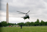 Photo - US President Joe Biden and First Lady Jill Biden arrive to the White House Ellipse on Marine One after a visit to Virginia