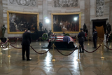 Photo - United States Representative Dan Kildee (Democrat of Michigan) pays his respects to US Capitol Police officer William Evans as he lies in honor at the US Capitol in Washington DC on Tuesday April 13 2021Credit Greg Nash  Pool via CNPAdMedia