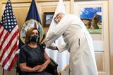 Photo - House Speaker Pelsoi recieves vaccination shot