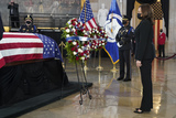 Photo - United States Vice President Kamala Harris pays respects to slain US Capitol Police officer William Billy Evans as he lies in honor at the Capitol in Washington Tuesday April 13 2021Credit Jacquelyn Martin  Pool via CNPAdMedia