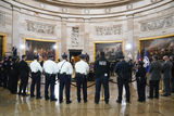 Photo - US Capitol Police officers pay their respects to slain US Capitol Police officer William Billy Evans as he lies in honor at the Capitol in Washington Tuesday April 13 2021 Credit J Scott Applewhite  Pool via CNPAdMedia