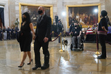 Photo - US Capitol Police officer Ken Shaver who was injured in the attack that killed Evans walks with Kristina Medina after pays their respects to slain US Capitol Police officer William Billy Evans as he lies in honor at the Capitol in Washington Tuesday April 13 2021 Credit Jacquelyn Martin  Pool via CNPAdMedia