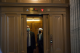 Photo - Senators Departs Senate Chamber Following a Vote