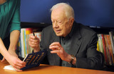 Photo - Jimmy Carter signs copies of his new book Faith