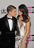 Photo - Justin Bieber  Selena Gomez arriving at the 2011 American Music Awards at the Nokia Theatre LA Live in downtown Los AngelesNovember 20 2011  Los Angeles CAPicture Paul Smith  Featureflash