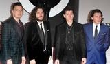 Arctic Monkeys Photo - London UK The Arctic Monkeys  at the The BRIT Awards with MasterCard 2014 Red Carpet arrivals at the 02 Arena London 19th February 2014  RefLMK73-47701-200214Keith MayhewLandmark MediaWWWLMKMEDIACOM