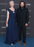 Photo - LOS ANGELES CALIFORNIA USA - NOVEMBER 02 Alexandra Grant and Keanu Reeves arrive at the 2019 LACMA Art  Film Gala held at the Los Angeles County Museum of Art on November 2 2019 in Los Angeles California United States (Photo by Xavier CollinImage Press Agency)